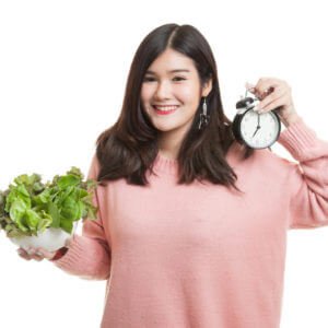 woman with clock and salad