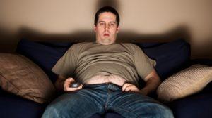Overweight slob watching TV