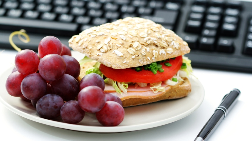 quick lunch in the office - bun and fresh grapes