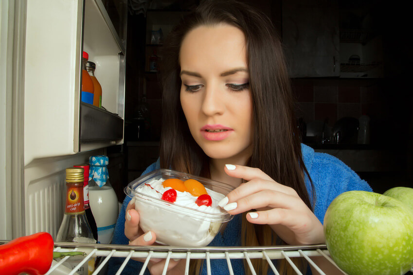 woman with dessert inside refrigerator