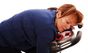 tired woman on bike