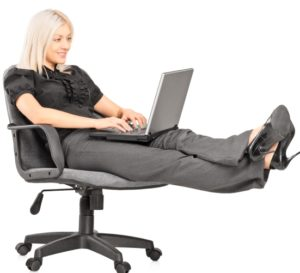 women working on computer on chair