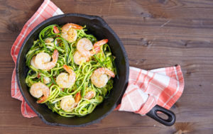 Low carb zucchini spaghetti with shrimp in a pan