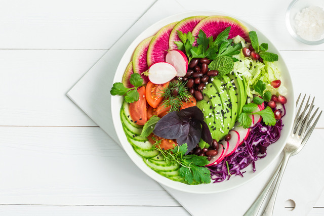 vegan lunch bowl. Avocado, red bean, tomato, cucumber, red cabbage  and watermelon radish  vegetables salad. healhty food. Top view