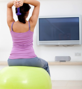 woman exercising on a ball
